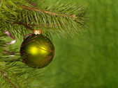 Xmas green ball on the green background. — Stock Photo