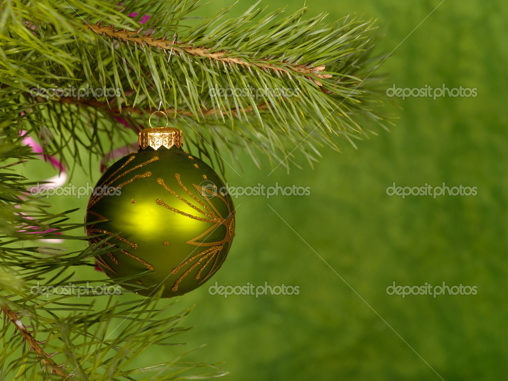Xmas green ball on the green background.   Stok fotoraf #1016137