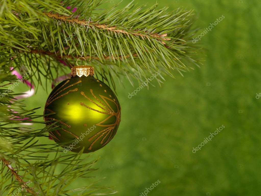 Xmas green ball on the green background.  — Photo #1016137