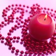 Holiday still life with candles on pink — Stock Photo