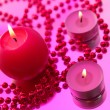 Holiday still life with candles on pink - Stockfoto