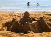 On the summer beach. Sand castle — Stock Photo