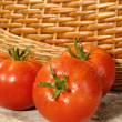 Stock Photo: Fresh ripe tomatoes with water drops on