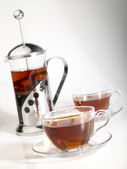 French-press withpair cups of tea and tr — Stock Photo