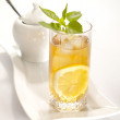 Cold black tea with lemon, ice and water — Stock Photo