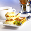 Small delicious pancakes with tea and be — Stock Photo