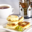 Small delicious pancakes with tea and ho - Stock Photo