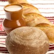 Delicious bread on traditional peasant t — Stock Photo #1093330