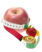 Red apple with tape measure and strawber — Stock Photo