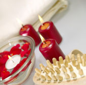 Bathroom still-life with candles and ros — Stock Photo