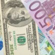 Stock Photo: Money background from dollars and euro b