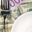Royalty-Free Stock Photo: Finance dinner background. Dollars and E