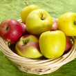 Fresh juicy apples on green background i — Stock Photo #1193606