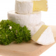 Camembert cheese with parsley on wooden — Stock Photo