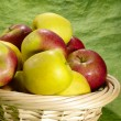 Wet juicy apples on green background in — Stock Photo #1195841