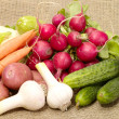 Fresh tasty vegetables on burlap — Stock Photo