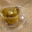 Cup of green teon hessiwith honey s — Stock Photo #1196726