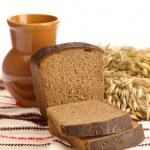 Delicious bread on folk background — Stock Photo
