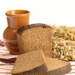 Stock Photo: Delicious bread on folk background