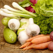 Stock Photo: Fresh tasty vegetables on brown backgrou