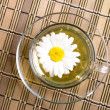 Cup pf tea with flower on bamboo backgro - Stock Photo