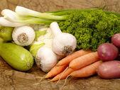 Fresh tasty vegetables on brown backgrou — Stock Photo