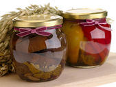 Home preserves on wooden background — Stock Photo