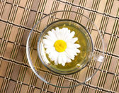 Cup pf tea with flower on bamboo backgro — Stock Photo