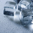 Ice cube and water drops — Stock Photo