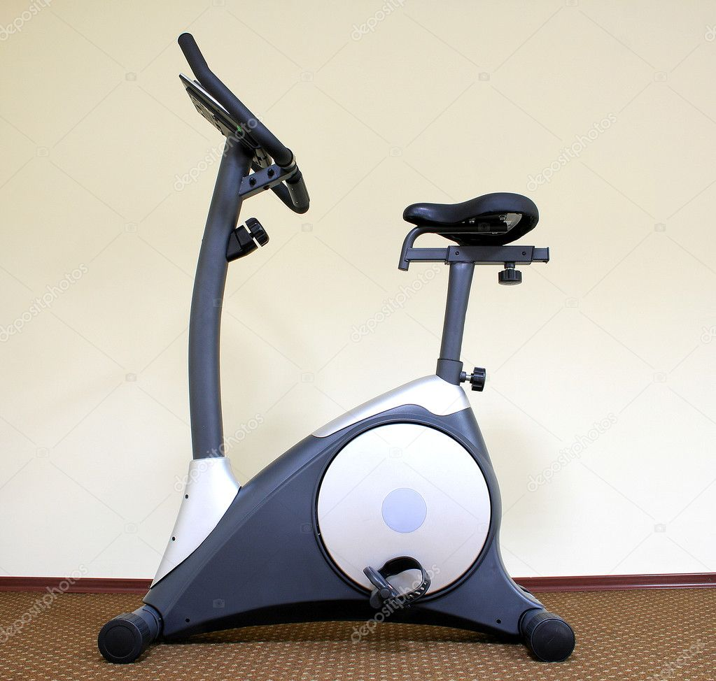 Stationary bicycle and Gym machine — Stock Photo #1016030