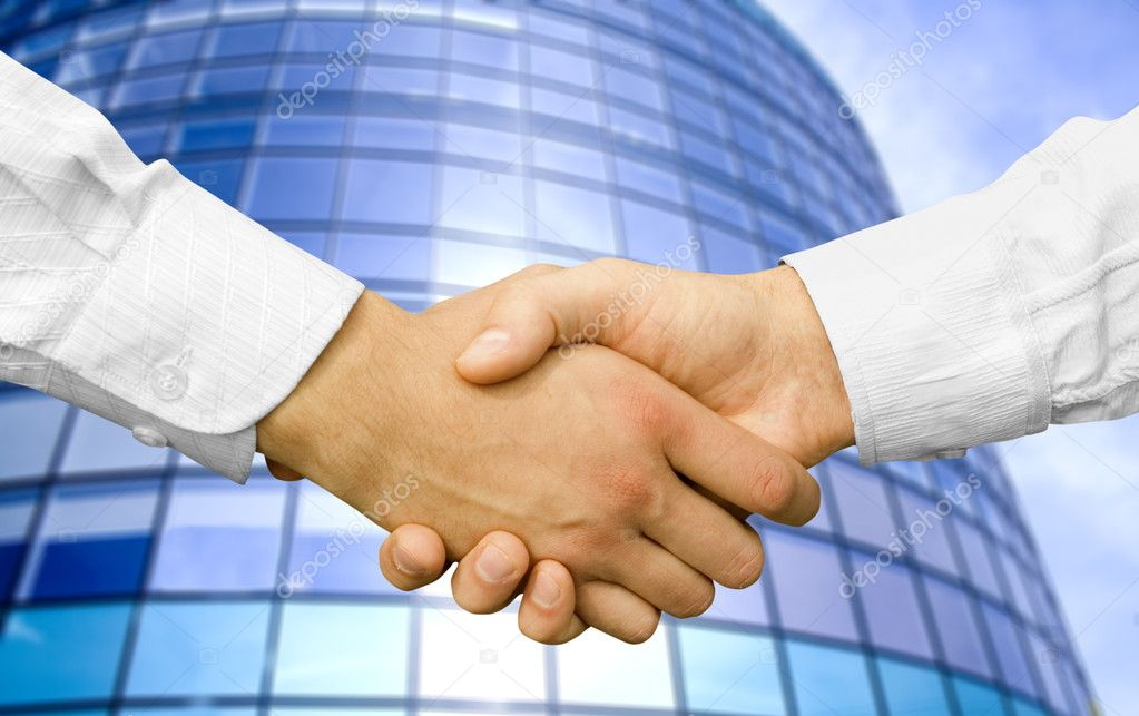 Handshake with modern skyscrapers as background  Stock Photo #1023613