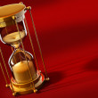 Stock Photo: Old gold sand clock measuring time
