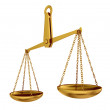 Empty gold scales - Stock Photo