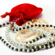 Royalty-Free Stock Photo: Pearls and red  pocket