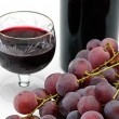 Wine bottle and wineglass with grape — Stock Photo #1011460
