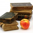 Old religious books and apple — Stock Photo