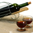 Wine bottle in basket — Stock Photo