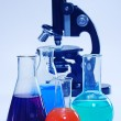 Laboratory glassware and microscope — Stock Photo #1013573