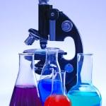 Laboratory glassware and microscope — Stock Photo