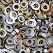 Nuts and washers in a drawer of hardwa — Stock Photo