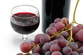 Wine bottle and wineglass with grape — Stock Photo