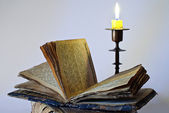 Old religious book and candlestick — Stock Photo