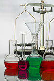 Balance and laboratory glassware — Stock Photo