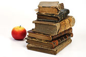 Old historic book and apple — Stock Photo
