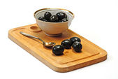 Olive in white cup — Stock Photo