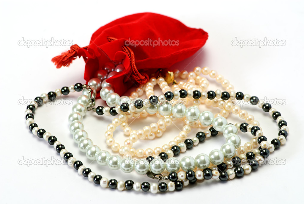 Pearls and red pocket on white isolated  Stock Photo #1011402