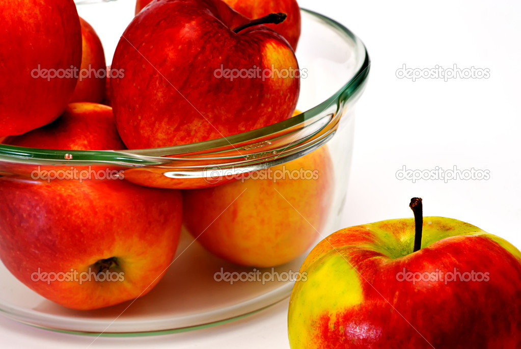 Apple in glasses cup on white — Stock Photo #1011442