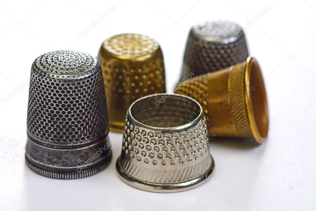 Five thimbles on white isolated — Stock Photo #1013559