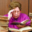 Royalty-Free Stock Photo: Old woman in library with religious