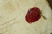 Old grunge paper with sealing wax — Stock Photo
